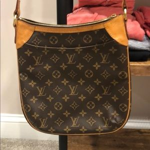 Authentic Louis Vuitton cross body bag. Odeon PM
